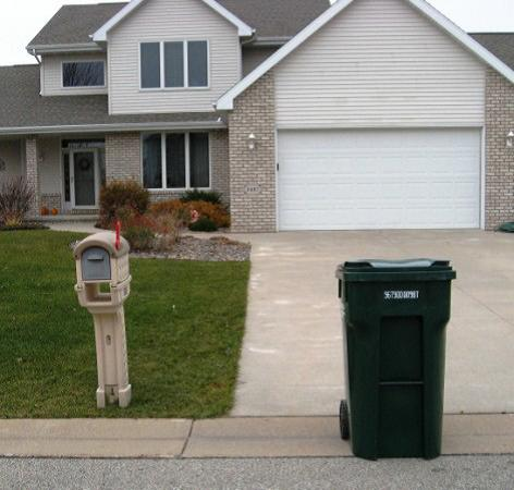 House with mailbox and garbage cart