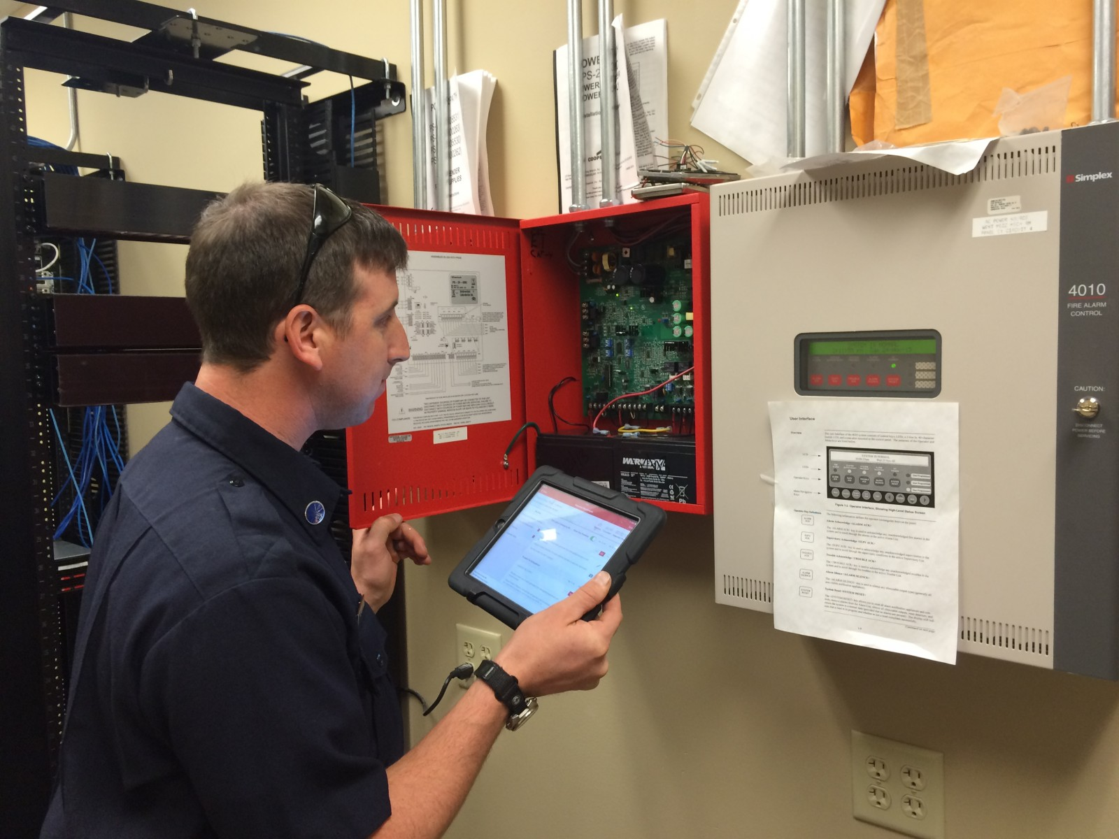 GCFD Firefighter Inspecting a Fire Alarm Panel